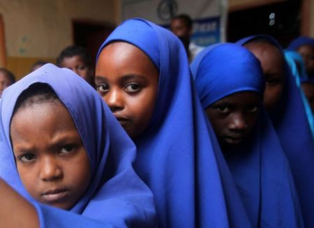 Somali students queue outside a classroom to attend examination classes at Bustaale Primary and Secondary school in capital Mogadishu