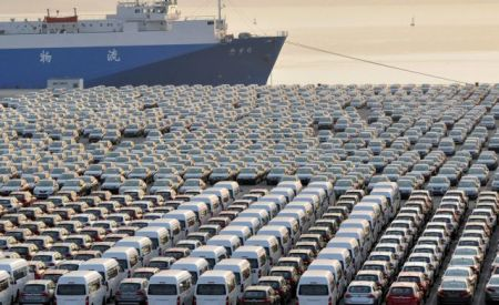 Chinese cars wait for export at a port in Dalian